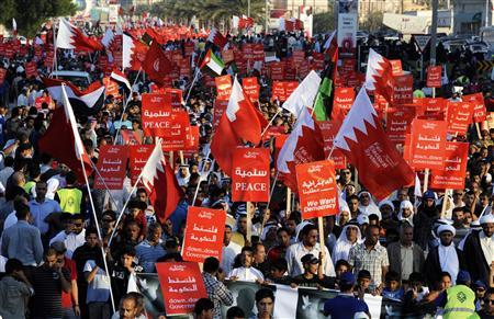 Anti-government protesters hold banners as they march during a rally organised by all opposition societies of Bahrain in Budaiya, west of Manama November 25, 2011.  REUTERS/ Hamad I Mohammed