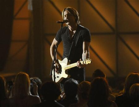 Keith Urban performs ''You Gonna Fly''  at the 45th Country Music Association Awards in Nashville, Tennessee November 9, 2011.  REUTERS/Tami Chappell