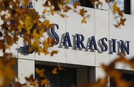 A logo is seen on a branch office of Swiss Bank Sarasin in Basel, November 14, 2011.  REUTERS/Christian Hartmann