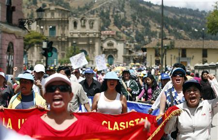 Protesters march during the second day of strike against Newmont's proposed $4.8 billion Conga gold mine, at the Andean city of Cajamarca November 25, 2011. REUTERS/Enrique Castro-Mendivil