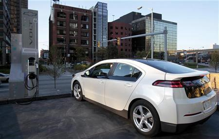 A Chevrolet Volt sits next to a newly installed electric vehicle charging station outside General Motor Co world headquarters in Detroit, Michigan October 12, 2010. REUTERS/Rebecca Cook