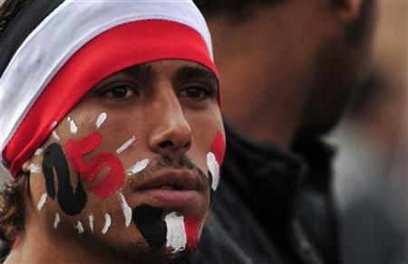 A protester with his face painted the colours of the Egyptian flag looks on during a demonstration against the military council in Cairo's Tahrir square November 25, 2011. REUTERS/Esam Al-Fetori