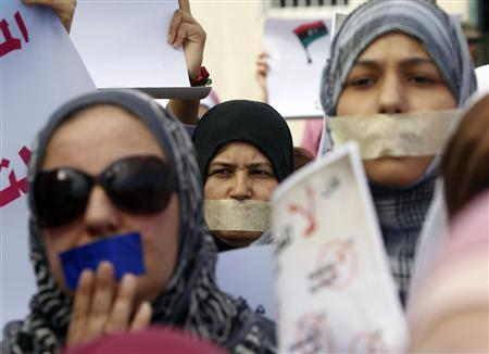 Libyan women with taped mouths take part in a silent march in support of the women who were raped during the recent war in Libya, in Tripoli November 26, 2011. REUTERS/Mohammed Salem