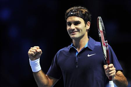 Roger Federer of Switzerland reacts after winning his singles semi-final tennis match against David Ferrer of Spain at the ATP World Tour Finals at the O2 Arena in London November 26, 2011. REUTERS/Toby Melville