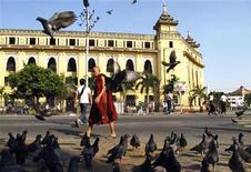 A Buddhist monk walks past the City Hall in downtown Yangon November 5, 2010.  REUTERS/stringer