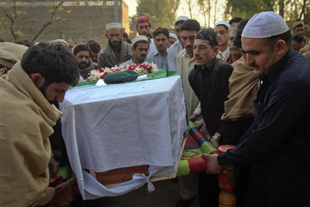 Relatives and residents carry the flag-draped coffin of solider Najeebullah, who was killed in a Nato cross-border attack one day earlier, before his funeral in his hometown Charsadda in northwest Pakistan November 27, 2011. REUTERS/Mian Khursheed