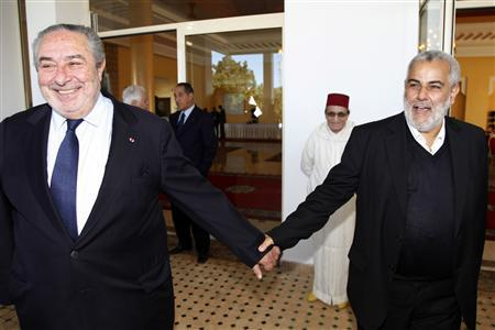 Abdelilah Benkirane (R), secretary-general of Morocco's moderate Islamist Justice and Development Party (PJD), welcomes Serge Berdugo, head of the council of Jewish community in Morocco, in Rabat November 26, 2011. REUTERS/Youssef Boudlal
