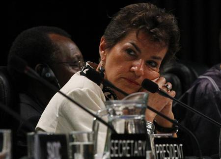 United Nations Framework Convention on Climate Change (UNFCCC) Executive Secretary Christiana Figueres listens to speakers at the opening plenary session of the Conference of the Parties (COP17) in Durban, November 28, 2011.   REUTERS/Mike Hutchings