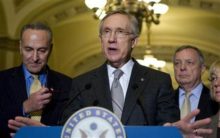Senate Majority Leader Harry Reid (D-NV) (2nd L) stands with Senator Charles Schumer (D-NY) (l) and Senator Dick Durbin (D-IL) (R) as he talks to reporters about the senate's vote on debt ceiling legislation at the U.S. Capitol in Washington, August 2, 2011. REUTERS/Jonathan Ernst