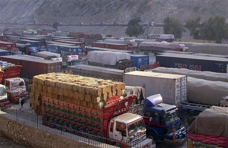 Cargo trucks, including those carrying supplies to NATO forces in Afghanistan, are seen halted along the Pakistan-Torkham border, after it was shut down to traffic, November 26, 2011. REUTERS/Shahid Shinwari