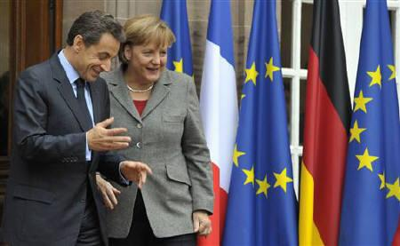 France's President Nicolas Sarkozy (L) speaks with German Chancellor Angela Merkel following a trilateral meeting on eurozone crisis with Italian Prime Minister Mario Monti in the eastern French city of Strasbourg, November 24, 2011. REUTERS/Philippe Wojazer