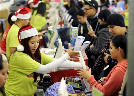 Shoppers pay for their purchases at an Old Navy store as ''Black Friday'' shoppers get an early start at the Citadel outlet stores on Thanksgiving in Los Angeles, California November 24, 2011. REUTERS/Gus Ruelas