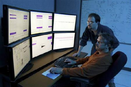 Department of Homeland Security (DHS) researchers use advanced modeling and simulation equipment as they work on the DHS Control Systems Security Program (CSSP) in this handout photo taken April 28, 2010 at the Idaho National Laboratory in Idaho Falls, Idaho. REUTERS/Chris Morgan/Idaho National Laboratory/Files