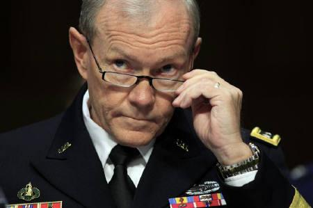Chairman of the Joint Chiefs of Staff Army Gen. Martin Dempsey testifies during a hearing held by the Senate Armed Services Committee on security issues relating to Iraq on Capitol Hill in Washington November 15, 2011. REUTERS/Kevin Lamarque