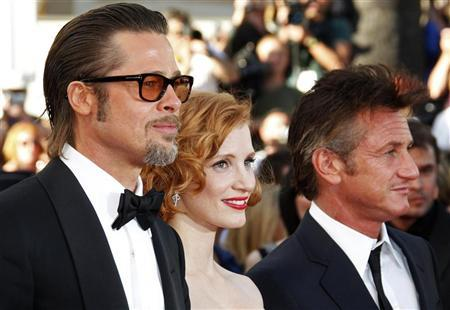 Cast members Brad Pitt (L), Jessica Chastain (C) and Sean Penn pose on the red carpet as they arrive for the screening of the film ''The Tree of Life'', by director Terrence Malick, in competition at the 64th Cannes Film Festival, May 16, 2011.  REUTERS/Vincent Kessler