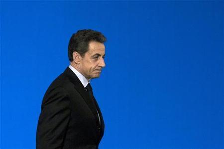 France's President Nicolas Sarkozy walk on stage at a ceremony for winners of the competition for the Best French workers at the Elysee Palace, in Paris, November 25, 2011.    REUTERS/Fred Dufour/Pool