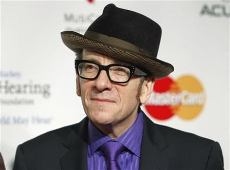 British recording artist Elvis Costello arrives at the 2011 MusiCares Person of the Year tribute honoring Barbra Streisand in Los Angeles, February 11, 2011. REUTERS/Danny Moloshok