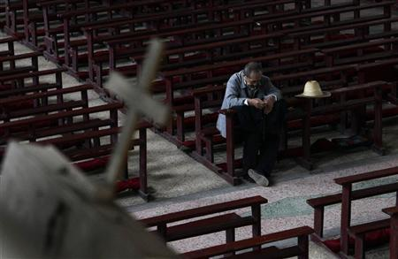 A catholic prays ahead of a mass at the Liuhe Catholic Church in Liuhe village on the outskirts of Qingxu county, northern China's Shanxi province, September 10, 2011. REUTERS/Jason Lee