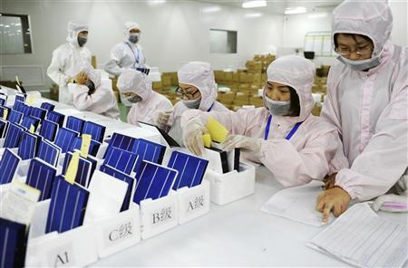 Employees inspect and sort solar panels into different quality categories at an LDK Solar company workshop in Hefei, Anhui province, China in this November 10, 2011 file photo.         REUTERS/Stringer/Files