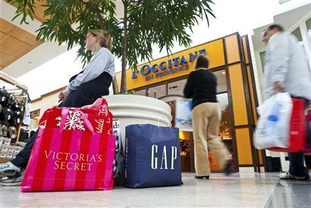 A woman rests while shopping at South Park mall in Charlotte, North Carolina November 25, 2011. REUTERS/Chris Keane