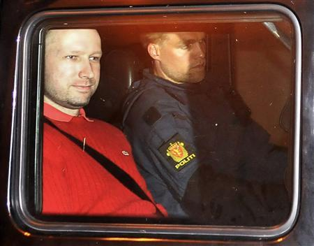 File picture shows Norwegian Anders Behring Breivik (L), the man accused of a killing spree and bomb attack in Norway, as he sits in the rear of a vehicle while transported in a police convoy as he is leaving the courthouse in Oslo July 25, 2011. REUTERS/Jon-Are Berg-Jacobsen/Aftenposten via Scanpix