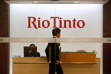 A man walks past the front desk at Rio Tinto Limited Shanghai Representative Office in Shanghai January 12, 2010.  REUTERS/Aly Song