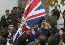 Protestors remove the flag of the British embassy in Tehran November 29, 2011.    REUTERS/Raheb Homavandi