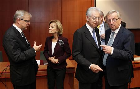 (L to R) European Monetary Affairs Commissioner Olli Rehn, Spain's Economy Minister Elena Salgado, Italy's Prime Minister and Finance Minister Mario Monti and Luxembourg's Prime Minister and Eurogroup chairman, Jean-Claude Juncker attend a Eurogroup meeting at the European Union council headquarters in Brussels, November 29, 2011.REUTERS/Yves Herman