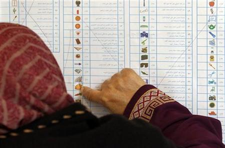 A woman reads a ballot paper before casting her vote at a polling station during the parliamentary election in Alexandria, November 29, 2011. REUTERS/Mohamed Abd El-Ghany