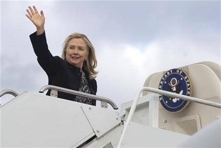 U.S. Secretary of State Hillary Clinton waves from her airplane prior to her departure to South Korea and Myanmar from Andrews Air Force Base in Maryland November 28, 2011. Picture taken November 28, 2011.  REUTERS/Saul Loeb/ Pool