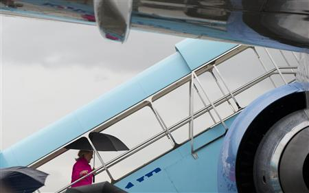 U.S. Secretary of State Hillary Clinton walks up the steps of her airplane prior to her departure from Gimhae International Airport in Busan November 30, 2011. REUTERS/Saul Loeb/Pool