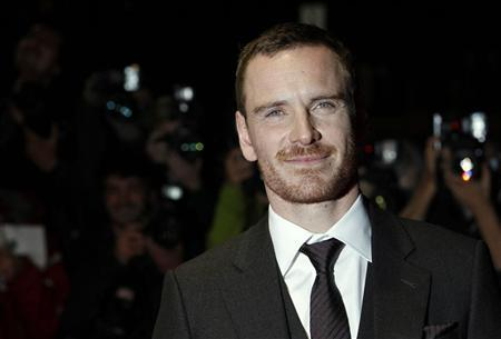 Michael Fassbender poses for photographers as he arrives for the premiere of ''A Dangerous Method'' during the BFI London Film Festival at Leicester Square in London October 24, 2011. REUTERS/Luke MacGregor