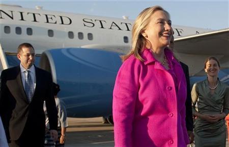 U.S. Secretary of State Hillary Clinton smiles upon her arrival in Naypyidaw, Myanmar November 30, 2011. REUTERS/Saul Loeb/Pool