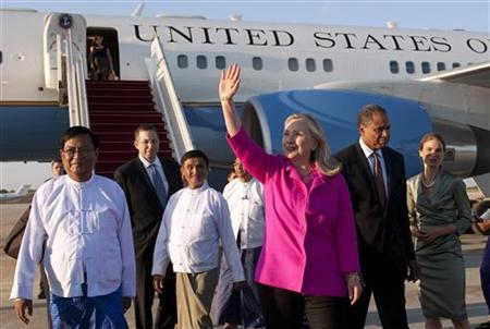 U.S. Secretary of State Hillary Clinton waves alongside Myanmar Deputy Foreign Minister Myo Myint (L) upon her arrival in Naypyidaw, Myanmar November 30, 2011. REUTERS/Saul Loeb/Pool
