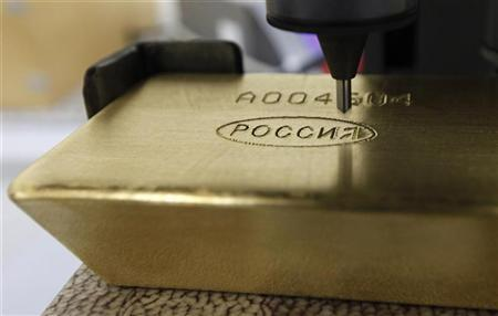 A machine engraves information on an ingot of 99.99 percent pure gold at the Krastsvetmet nonferrous metals plant in Russia's Siberian city of Krasnoyarsk, March 28, 2011. REUTERS/Ilya Naymushin