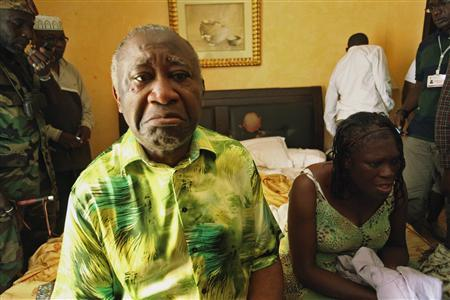 Ivory Coast's Laurent Gbagbo (L) and his wife Simone sit in a room at Hotel Golf in Abidjan, after they were arrested, in this April 11, 2011 file photo. The International Criminal Court confirmed former Ivory Coast President Laurent Gbagbo had been detained in The Hague on November 30, 2011, following his arrest on charges of crimes against humanity and transfer from Ivory Coast overnight.  REUTERS/Stringer/Files