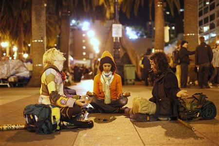 A group of demonstrators meditate near Occupy San Francisco's encampment in San Francisco, California November 18, 2011. REUTERS/Stephen Lam