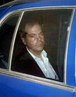 John Hinckley Jr. arrives at the E. Barrett Prettyman U.S. District Court in Washington in this November 19, 2003 file photo.  REUTERS/Brendan Smialowski