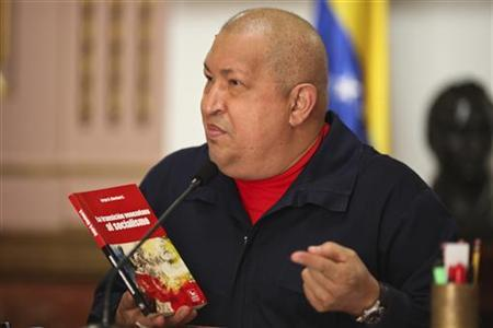 Venezuela's President Hugo Chavez attends a cabinet meeting in Caracas November 27, 2011. REUTERS/Miraflores Palace/Handout