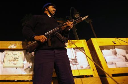 An Egyptian Navy police stands guard ballot boxes after voting closed  at a center for vote counting during the second day of parliamentary elections in Alexandria, November 29, 2011. REUTERS/Mohamed Abd El-Ghany