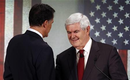 Republican presidential candidate former U.S. House of Representatives Speaker Newt Gingrich (R) shakes hands with former Massachusetts Governor Mitt Romney after a South Carolina Republican party presidential debate in Spartanburg, South Carolina November 12, 2011.  REUTERS/Chris Keane