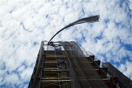 A piece of construction safety netting blows in the wind while hanging off a building in the Brooklyn borough of New York October 28, 2010.  REUTERS/Lucas Jackson