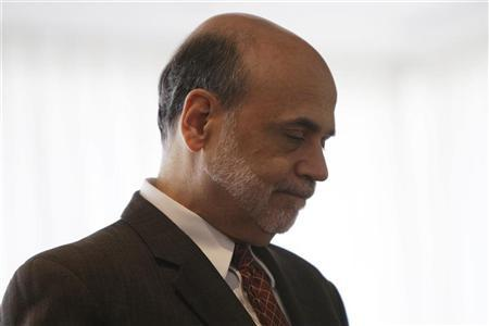 Federal Reserve Chairman Ben Bernanke waits to be introduced at a conference on ''Small Business and Entrepreneurship during an Economic Recovery'' at the Federal Reserve in Washington, November 9, 2011.  REUTERS/Hyungwon Kang