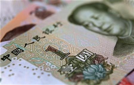 A one yuan banknote is seen in this photo illustration taken in Beijing December 9, 2010. To mREUTERS/Petar Kujundzic