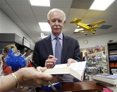Former US Airways Captain Chesley Sullenberger of U.S. Airways flight 1549 signs books at Carolinas Aviation Museum in Charlotte, North Carolina June 11, 2011.   REUTERS/Jim R. Bounds