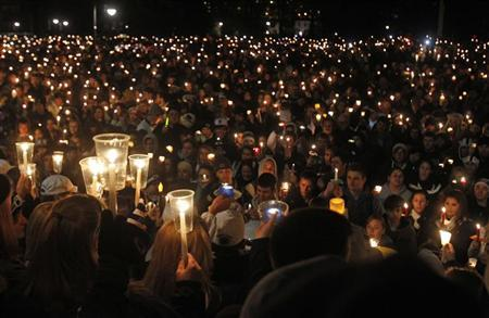 Penn State students hold candles during a candlelight vigil to show their support for sexual abuse victims involved in the recent controversy in State College, Pennsylvania November 11, 2011.  REUTERS/Tim Shaffer