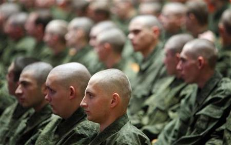 New Russian draftees sit during a ceremony to celebrate ''Recruit Day'' in the southern Russian city of Stavropol November 16, 2011. REUTERS/Eduard Korniyenko/Files