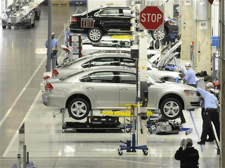 Volkswagen employees inspect an 2012 Passat in the assembly finish department in Chattanooga Tennessee, December 1, 2011. The plant has received a platinum certification from the U.S. Green Building Council, and is the first and only automotive plant in the world to receive the award.  REUTERS/Billy Weeks