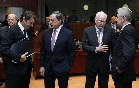 (L to R) France's Finance Minister Francois Baroin, European Central Bank (ECB) President Mario Draghi, European Investment Bank (EIB) President Philippe Maystadt and Italy's Prime Minister and Finance Minister Mario Monti attend a European Union finance ministers meeting in Brussels November 30, 2011. EU finance ministers and officials meet in Brussels on Wednesday to discuss plans to deal with the sovereign debt crisis. REUTERS/Yves Herman