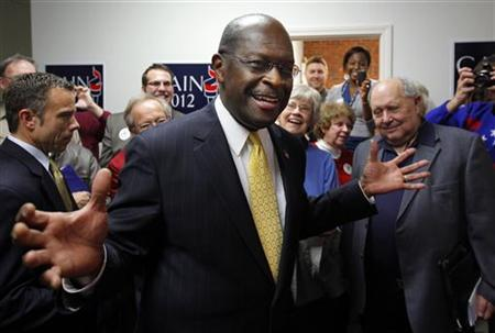 Republican presidential candidate and businessman Herman Cain greets supporters in his campaign headquarters in Manchester, New Hampshire November 30, 2011. REUTERS/Brian Snyder